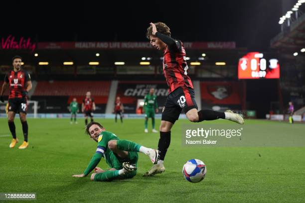 Alan Browne of Preston North End tackles Rodrigo Riquelme of AFC Bournemouth during the Sky Bet Championship match between AFC Bournemouth and...