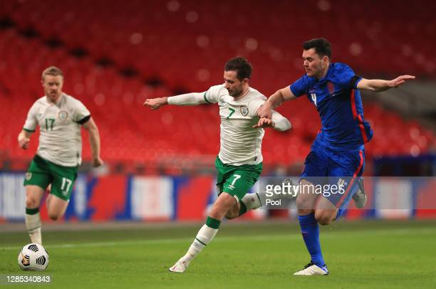 Alan Browne of Republic of Ireland looks to break past Michael Keane of England during the international friendly match between England and the...