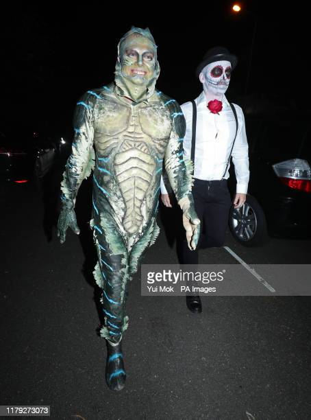 Alan Carr and his husband Paul Drayton arriving at a Halloween party hosted by Jonathan Ross at his house in north London