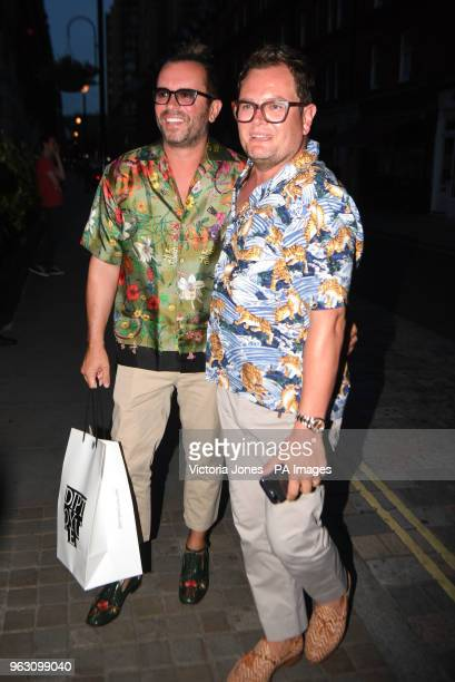 Alan Carr and partner Paul Drayton arriving at Chiltern Firehouse in London to celebrate Kylie Minogue's 50th birthday