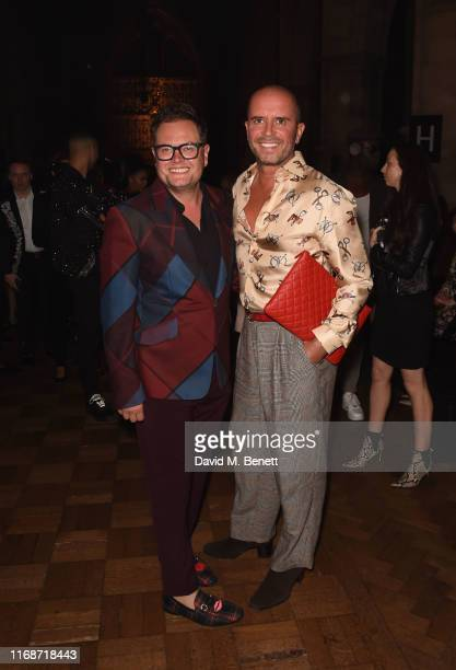 Alan Carr and Paul Drayton attend JULIEN MACDONALD PRESENTS Julien x Gabriela Spring/Summer 2020 for LFW during London Fashion Week at Southwark...
