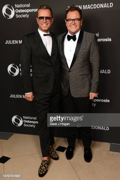 Alan Carr and Paul Drayton attend the Julien Macdonald Fashion Show for National Osteoporosis Society at Lancaster House on November 21, 2018 in...