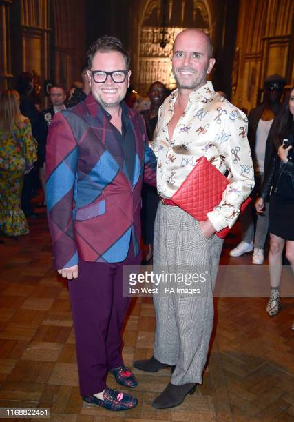 Alan Carr and Paul Drayton on the front row for Julien MacDonald Spring/summer 2020Fashion Show held at Southwark Cathedral London