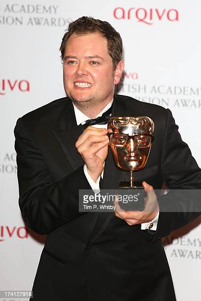Alan Carr poses with his award for Best Entertainment Performance in the press room at the Arqiva British Academy Television Awards 2013 at the Royal...
