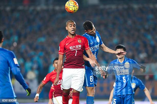 Alan Carvalho of Guangzhou Evergrande and Trent Sainsbury of Jiangsu Suning head the ball during the final second leg of Yanjing Beer 2016 Chinese...