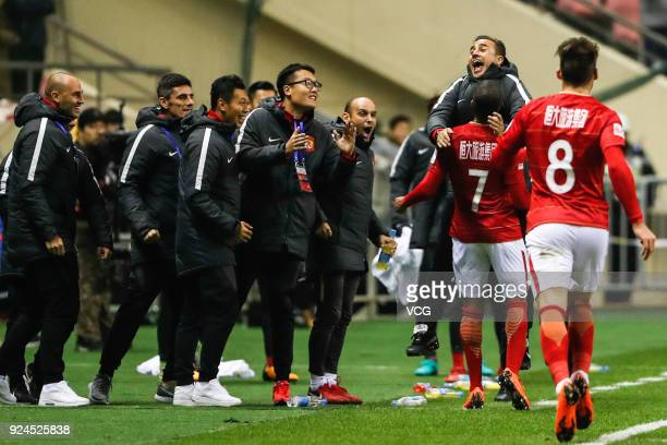 Alan Carvalho of Guangzhou Evergrande celebrates a goal with head coach Fabio Cannavaro during the 2018 Chinese Football Association Super Cup...