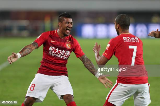 Alan Carvalho of Guangzhou Evergrande celebrates with Paulinho after scoring a goal during the 10th round match of 2017 Chinese Football Association...