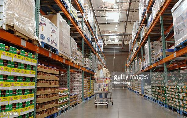 Alan Cater walks down the aisle inside a Costco store in Arvada Colorado on Friday December 9 2005 Sales at US wholesalers rose 12 percent in October...