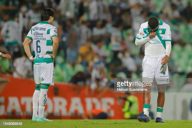 Alan Cervantes and Alessio da Cruz of Santos react after losing the 10th round match between Santos Laguna and Monterey as part of the Torneo Grita...