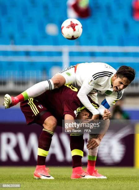 Alan Cervantes of Mexico challenges Ronaldo Pena of Venezuela during the FIFA U-20 World Cup Korea Republic 2017 group B match between Mexico and...