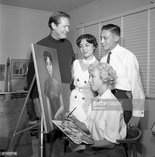 Alan Chiang grandson of Generalissimo Chiang KaiShek is giving a smile of approval of a portrait of his fiance Nancy Cecila Yeh Veng Zi by artist...