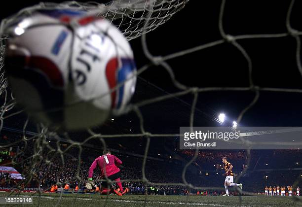 Alan Connell of Bradford scores with his penalty attempt past goalkeeper Wojciech Szczesny of Arsenal during the Capital One Cup quarter final match...