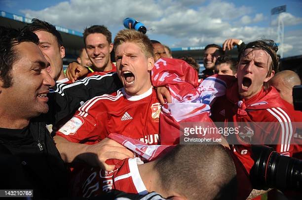 Alan Connell of Swindon Town celebrates their promotion with team mates during the npower League 2 match between Gillingham and Swindon Town at...
