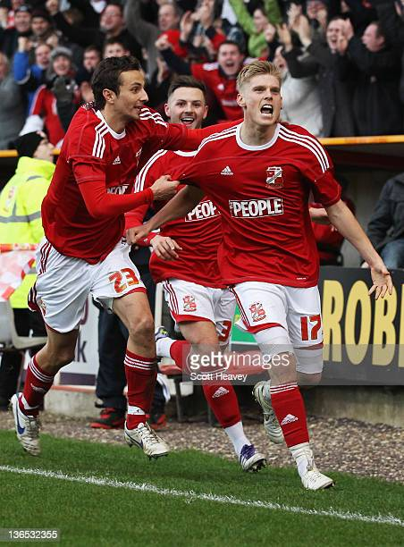 Alan Connell of Swindon Town celebrates with team mates Raffaele De Vita and Callum Kennedy as he scores their first goal during the FA Cup sponsored...