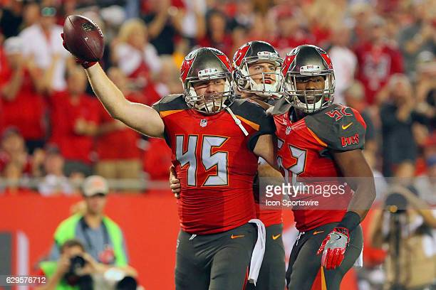 Alan Cross of the Buccaneers and Cameron Lynch of the Buccaneers celebrate pinning the Saints to within the one yard line during the NFL Game between...