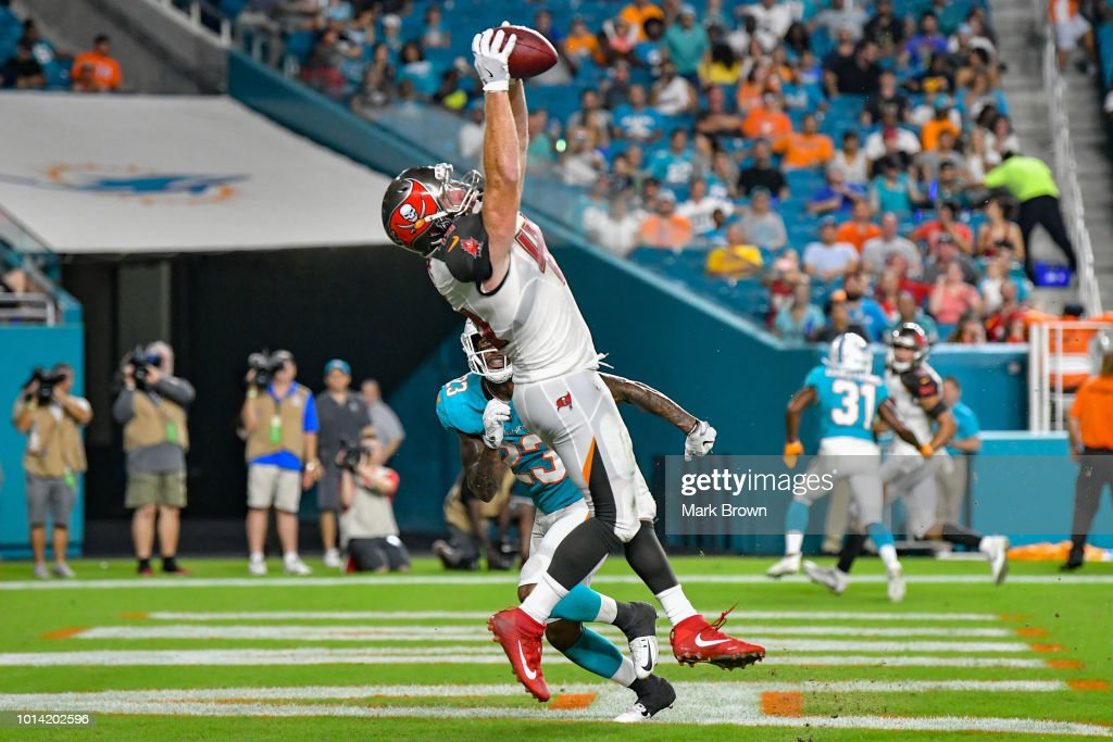 Alan Cross #45 of the Tampa Bay Buccaneers scores a touchdown in the third quarter during a preseason game against the Miami Dolphins at Hard Rock Stadium on August 9, 2018 in Miami, Florida.