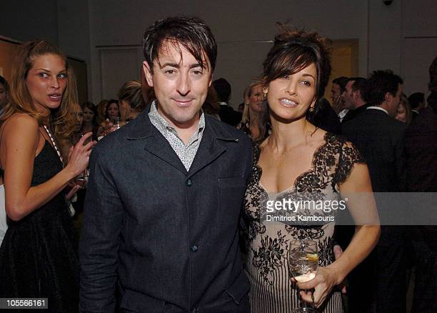 Alan Cumming and Gina Gershon during amfAR and ACRIA Honor Herb Ritts at Sotheby's in New York City New York United States