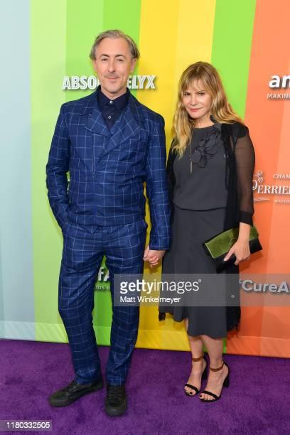Alan Cumming and Jennifer Jason Leigh attend the 2019 amfAR Gala Los Angeles at Milk Studios on October 10, 2019 in Los Angeles, California.