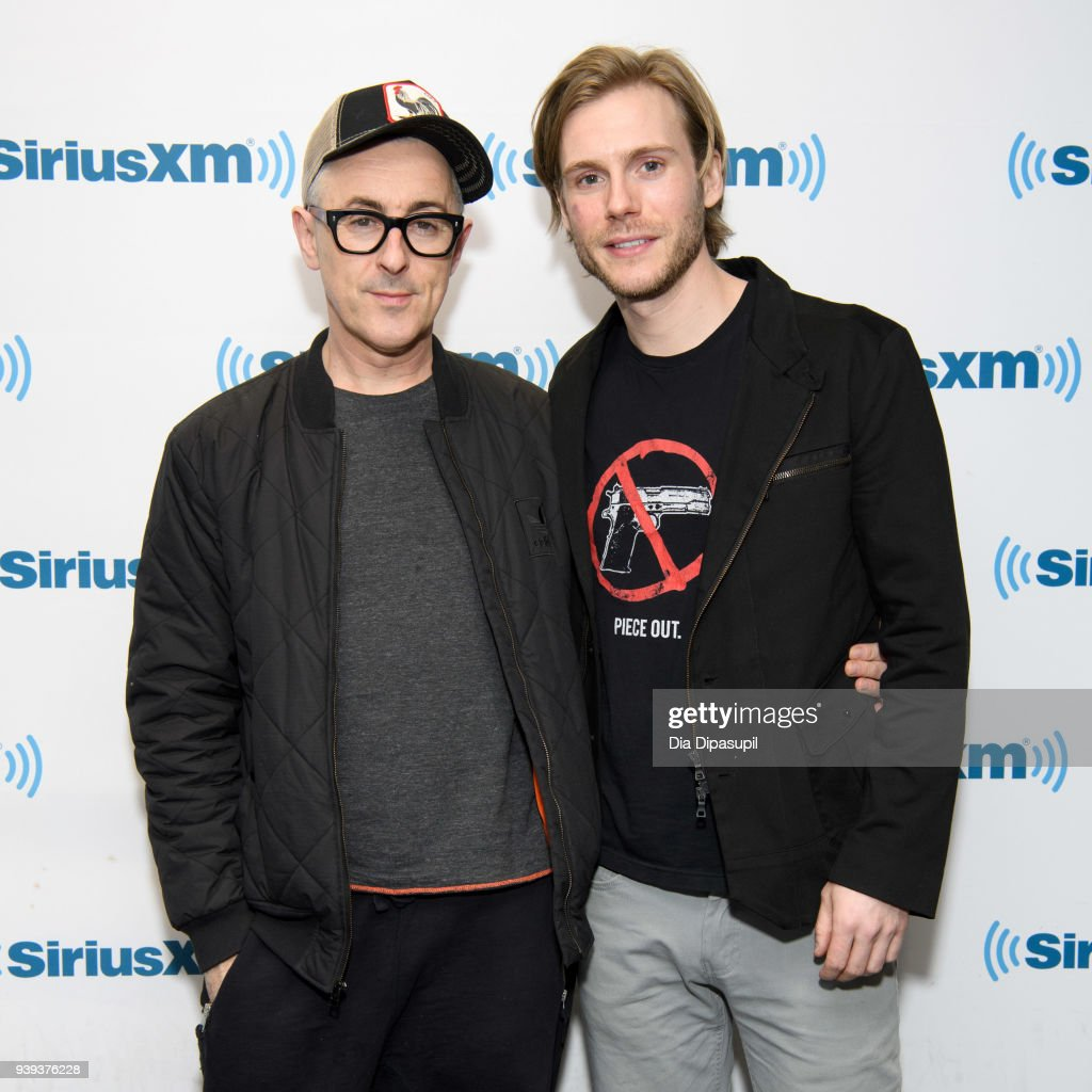 Alan Cumming (L) and Zachary Booth visit SiriusXM Studios on March 28, 2018 in New York City.