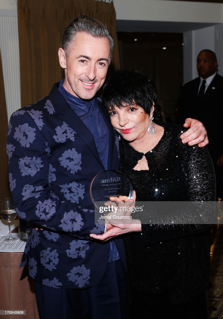 Alan Cumming recipient of the Award of Courage (L) and Liza Minelli pose backstage at the 4th Annual amfAR Inspiration Gala New York at The Plaza Hotel on June 13, 2013 in New York City.