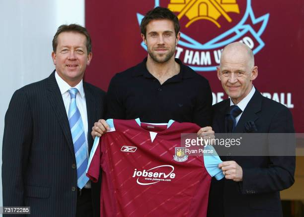 Alan Curbishley Manager of West Ham Matthew Upson of West Ham and Eggert Magnusson owner of West Ham pose at Upton Park on February 1 2007 in London...