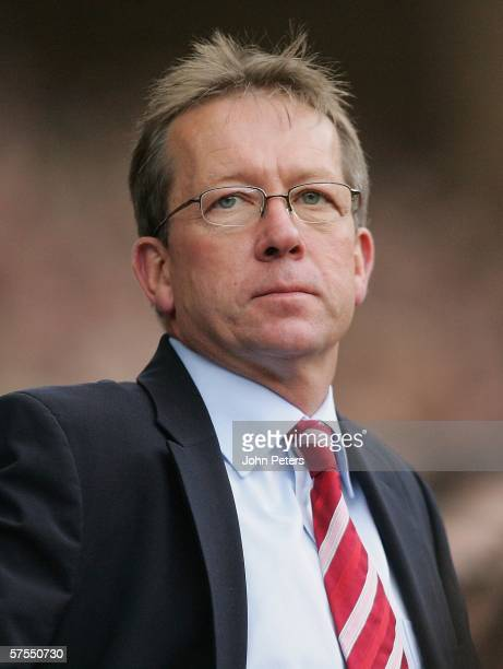 Alan Curbishley of Charlton watches from the dugout during the Barclays Premiership match between Manchester United and Charlton Athletic at Old...