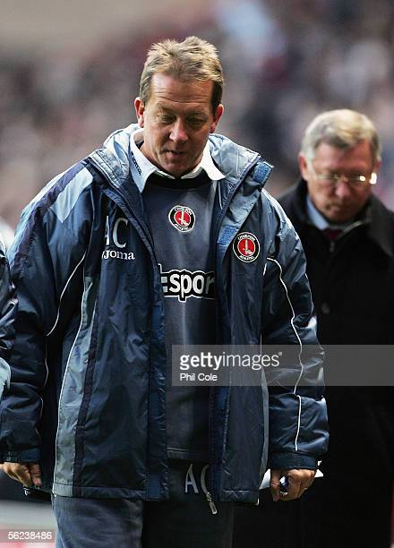 Alan Curbishley the Charlton Athletic Manager is followed by Sir Alex Ferguson the Manchester United Manager at half time during the Barclays...