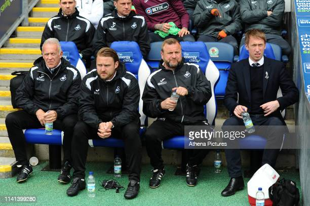 Alan Curtis, assistant coach, Bjorn Hamberg, assistant coach, Billy Reid, assistant manager and Graham Potter Manager of Swansea City during the Sky...