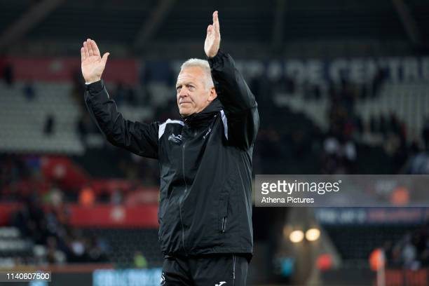 Alan Curtis, assistant coach for Swansea applauds the fans at the final whistle during the Sky Bet Championship match between Swansea City and Derby...