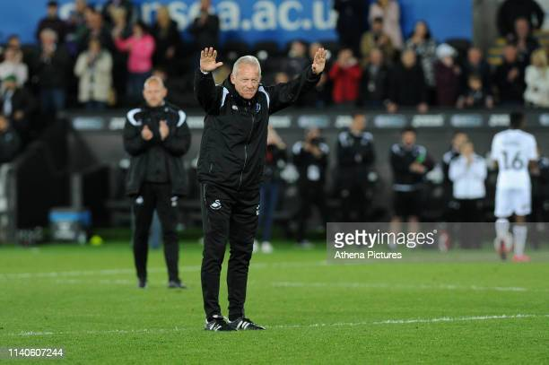 Alan Curtis, assistant coach for Swansea City applauds the fans at the final whistle during the Sky Bet Championship match between Swansea City and...