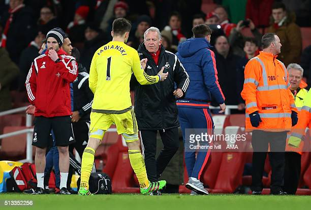 Alan Curtis, assistant coach of Swansea City congratulates Swansea City goalkeeper Lukasz Fabianski after the Barclays Premier League match between...