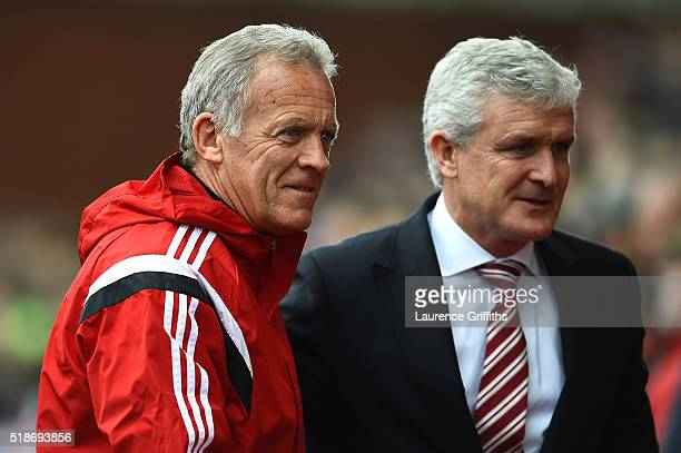 Alan Curtis assistant manager of Swansea City greets Mark Hughes manager of Stoke City prior to the Barclays Premier League match between Stoke City...
