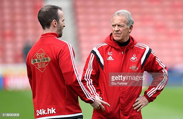 Alan Curtis , assistant manager of Swansea City looks on prior to the Barclays Premier League match between Stoke City and Swansea City at Britannia...