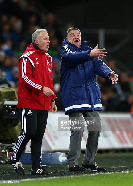 Alan Curtis caretaker Manager of Swansea City and Sam Allardyce, manager of Sunderland look on during the Barclays Premier League match between...