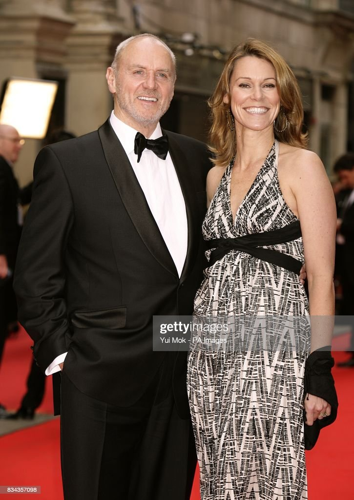 Alan Dale and wife Tracy arrive for the British Academy