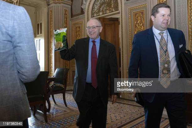 Alan Dershowitz lawyer for President Donald Trump holds up his bag of potato chips for members of the media while walking through the US Capitol in...