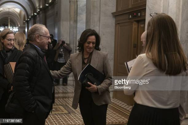 Alan Dershowitz lawyer for President Donald Trump second left speaks with Senator Kamala Harris a Democrat from California center at the US Capitol...