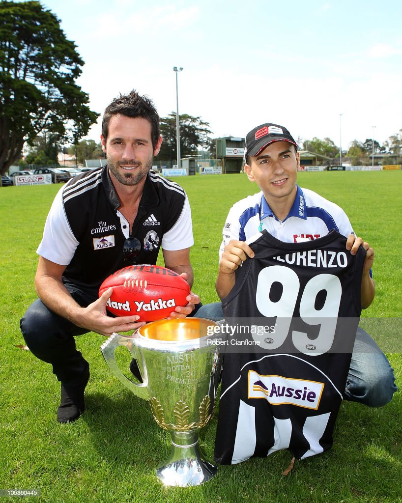 Alan Didak of the Collingwood Magpies poses with Jorge Lorenzo of Spain and the Fiat Yamaha Team as he prepares for the Australian MotoGP, which is round 16 of the MotoGP World Championship, at the Phillip Island Football Club on October 14, 2010 in Phillip Island, Australia.
