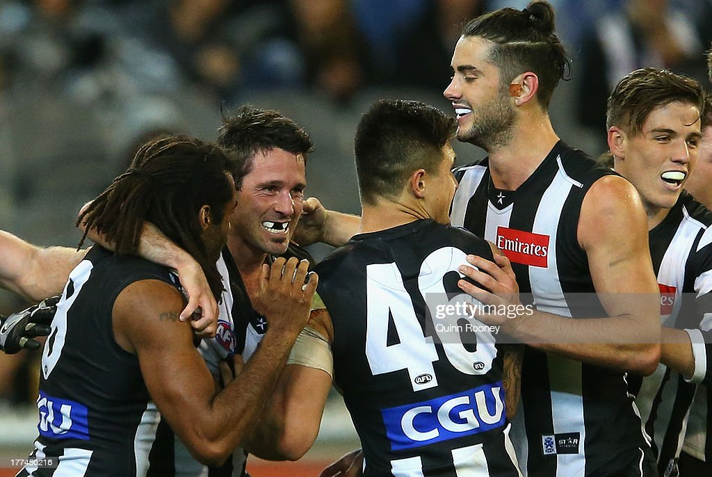 Alan Didak of the Magpies is congratulated by team mates after kicking a goal during the round 22 AFL match between the Collingwood Magpies and the West Coast Eagles at Melbourne Cricket Ground on August 23, 2013 in Melbourne, Australia.