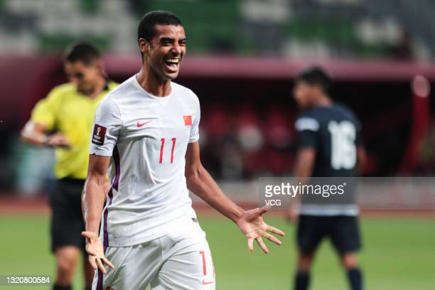 Alan Douglas Borges de Carvalho of China celebrates a point during the FIFA World Cup Asian qualifier Group A second round match between China and...