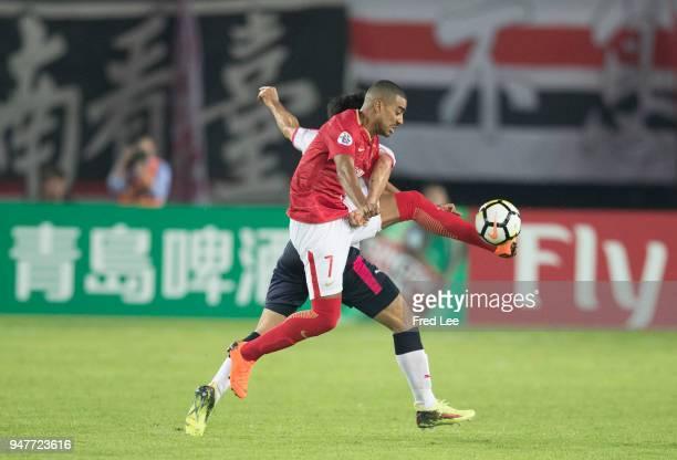 Alan Douglas Borges de Carvalho of Guangzhou Evergrande Taobao and Noriyuki Sakemoto of Cerezo Osaka during the 2018 AFC Champions League Group G...