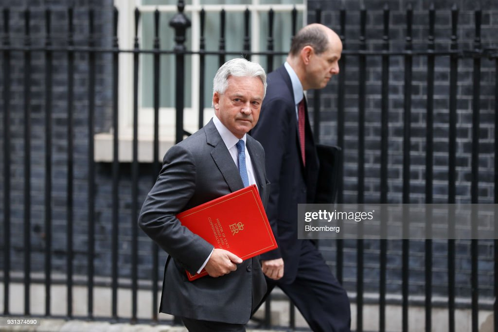 Alan Duncan, U.K. foreign office minister, left, arrives for a weekly meeting of cabinet ministers at number 10 Downing Street in London, U.K., on Tuesday, March 13, 2018. U.K. Prime Minister Theresa May publicly accused Russia of a chemical weapon attack on British soil and warned of retaliatory measures that will further strain relations between the West and the Kremlin. Photographer: Simon Dawson/Bloomberg via Getty Images