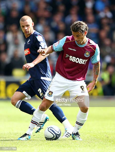 Alan Dunne of Millwall battles with David Bentley of West Ham United during the npower Championship match between Millwall and West Ham United at The...