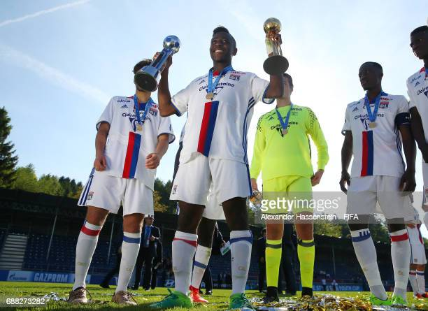 Alan Dzabana of Olympique Lyonnais celebrates with the trophy following his team's 10 victory during the Final match between Olympique Lyon vs RSC...