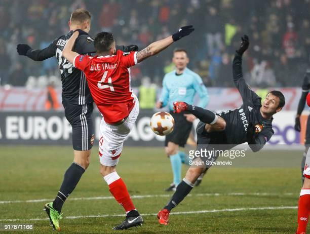 Alan Dzagoev of CSKA Moscow in action against Damien Le Tallec of Crvena Zvezda during UEFA Europa League Round of 32 match between Crvena Zvezda...