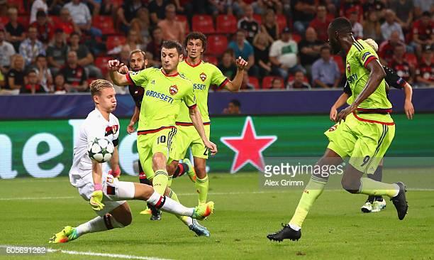 Alan Dzagoev of CSKA Moscow scores his teams first during the UEFA Champions League match between Bayer 04 Leverkusen and PFC CSKA Moskva at BayArena...