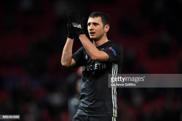 Alan Dzagoev of CSKA Moscow shows appreciation to the fans after the UEFA Champions League group A match between Manchester United and CSKA Moskva at...