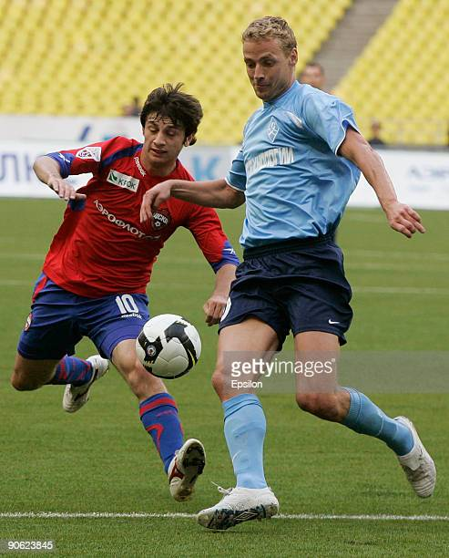 Alan Dzagoev of FC CSKA battles for the ball with Jiri Jarosik of Krylia Sovetov during the Russian Football League Championship match between FC...