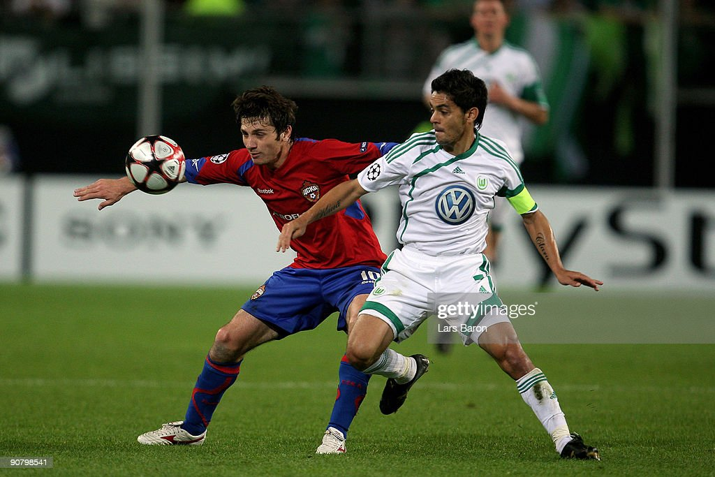 Alan Dzagoev of Moscow (L) is challenged by Josue of Wolfsburg during the UEFA Champions League Group B match between VfL Wolfsburg and CSKA Moscow at the Volkswagen Arena on September 15, 2009 in Wolfsburg, Germany.