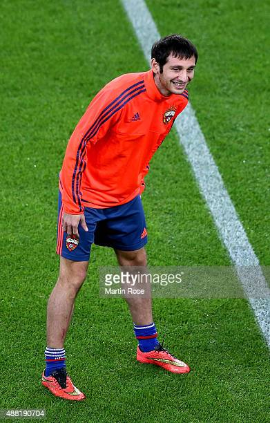 Alan Dzagoev of Moscow stretches during a training session ahead of the UEFA Champions League group B match between VfL Wolfsburg and CSKA Moscow at...